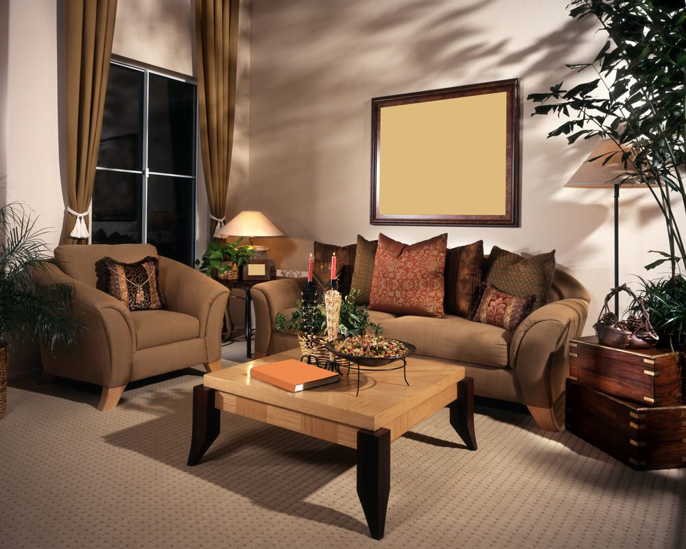 The warm color combinations of maple and walnut surfaced over the furniture and extravagant sofa set, while curtains traditionally fabricated match the overall design.