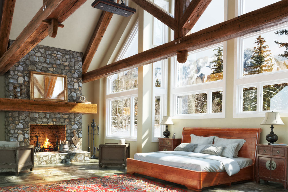 The stone fireplace is the central feature in this bedroom and the sitting area takes full advantage of the warmth and comfort.
