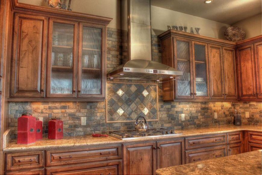 This lovely Craftsman kitchen features rustic, stained pine cabinetry and stone backsplash.The muted, organic colors are perfect for a Craftsman.