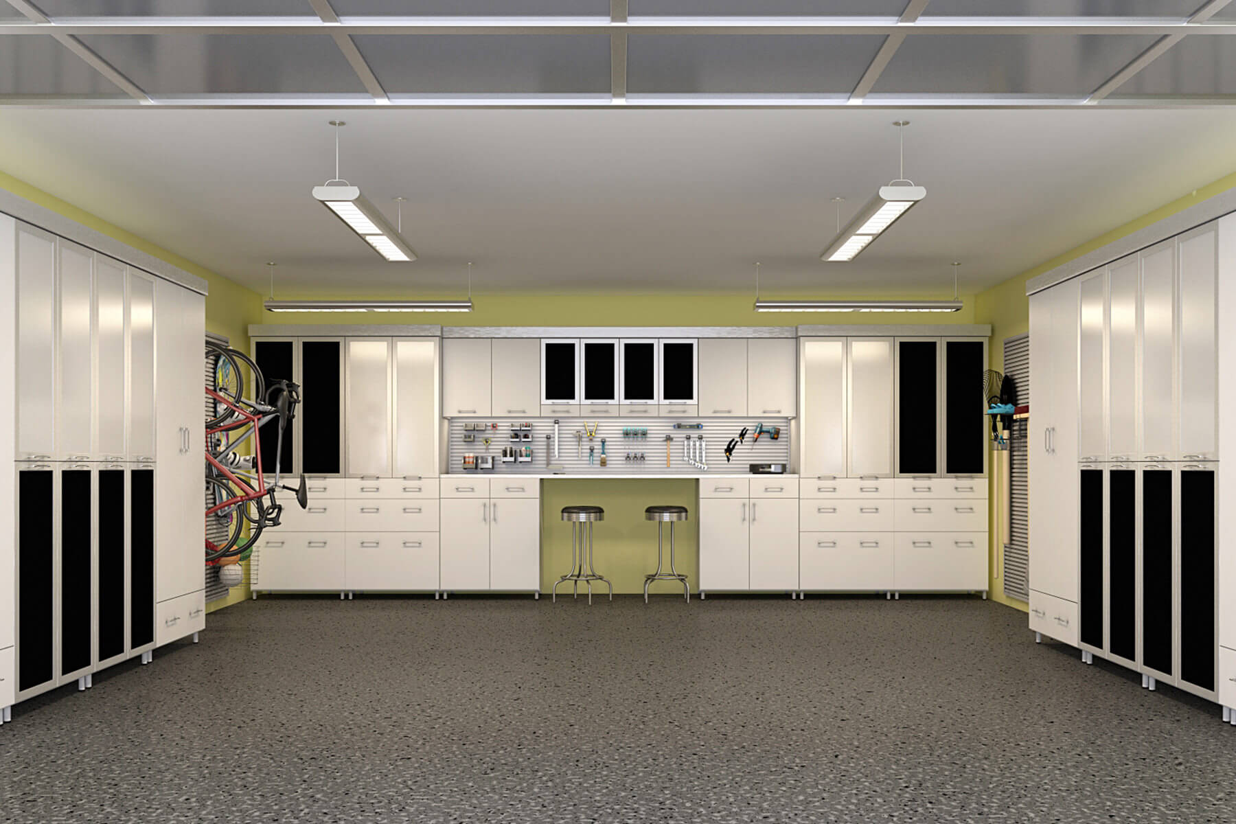 This simple garage features adjustable slatwalls at the center of the white melamine cabinets and to those embedded on the walls. These adjustable slatwalls make it convenient to hang tools and other items without worrying about space.