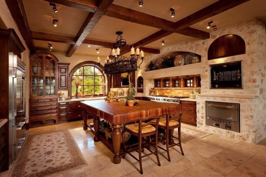Lots of stone and a few ornate antique pieces show a little Tuscan influence on this kitchen, but the handcrafted furniture and natural materials mark it as Craftsman.