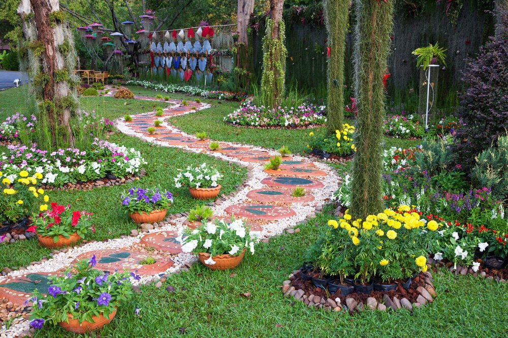 Awaiting at the end of the pathway are the potted flowers in red, purple and white blossoms.