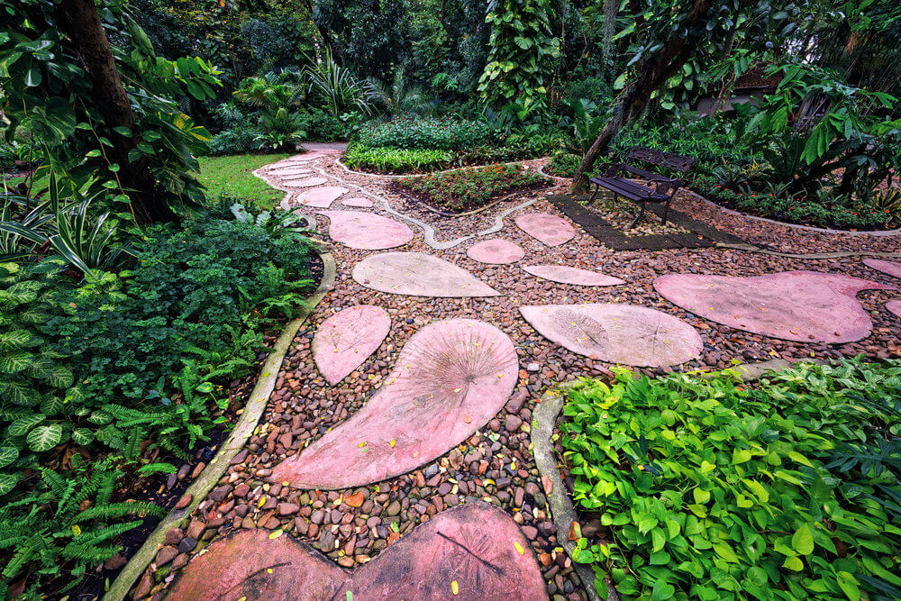 Pavers in irregular shapes resemble tadpoles swimming in a river of red water.