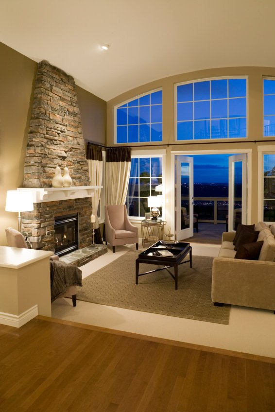 A touch of modern here, twisted into a nicely and elaborately designed West Coast Contemporary with large window, wide door opening, and stone fireplace.