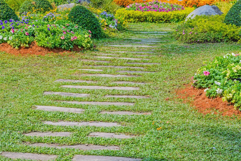This stepping stone pathway is composed of elongated pavers and carabao grass.