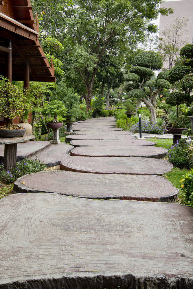 These stepping stones are designed as large wood cut pavers. They create a natural look, like a real tree trunk cut in pieces.