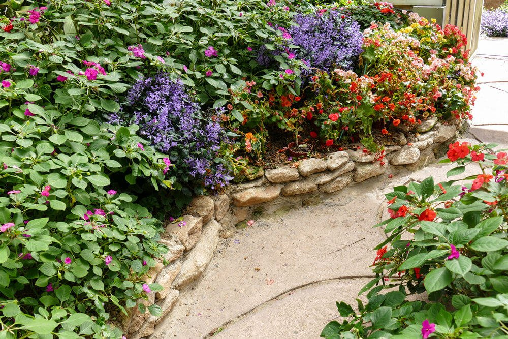 Cobble stones stacked at the edges with pavers designed with leaf skeleton art.