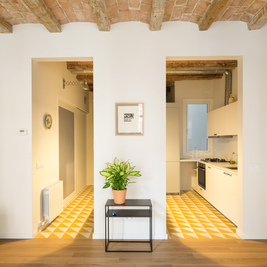 Pattern floor tiling and white vanities in the kitchen give an extra fabulous bright environment. The two passage ways look very communicable.