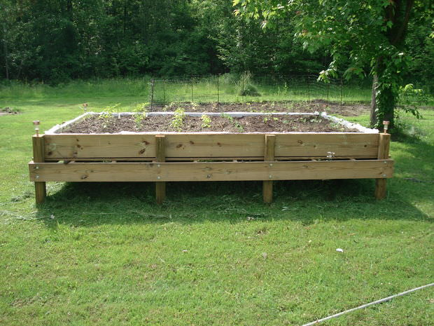 Who ever said a raised bed had to sit on the ground and be only so big? We say go big or go home! By placing the bed on stilts for that extra height, it makes the raised bed ideal for aging gardeners who may have difficulty getting around. Also, you needn't worry about the water draining and flooding your garden, as there are drainage holes in the bottom of the bed.