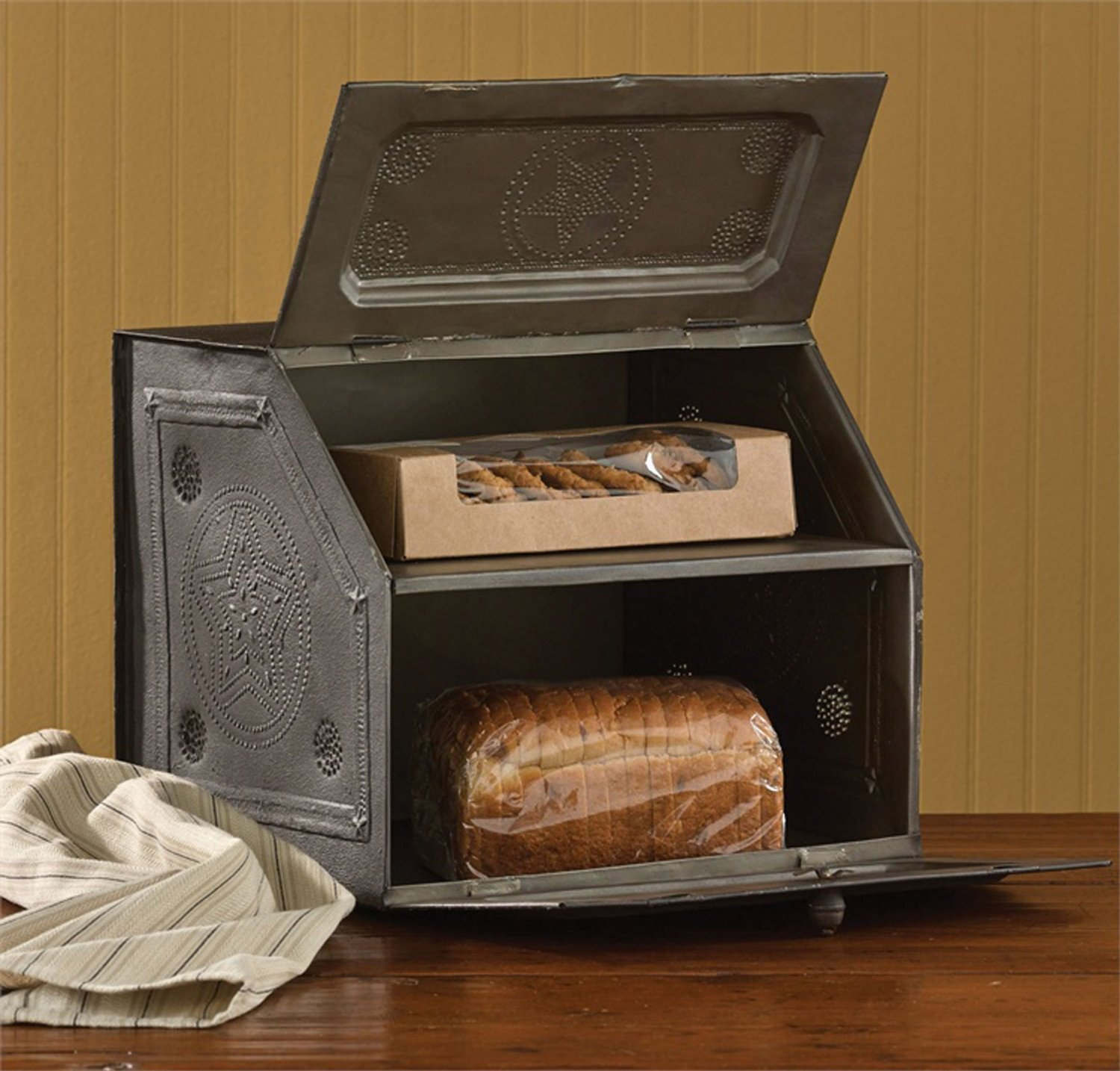 This antique tin breadbox, will give your kitchen a rustic feel. It is complete with two shelves, which gives you the option to use it as an organizer too.