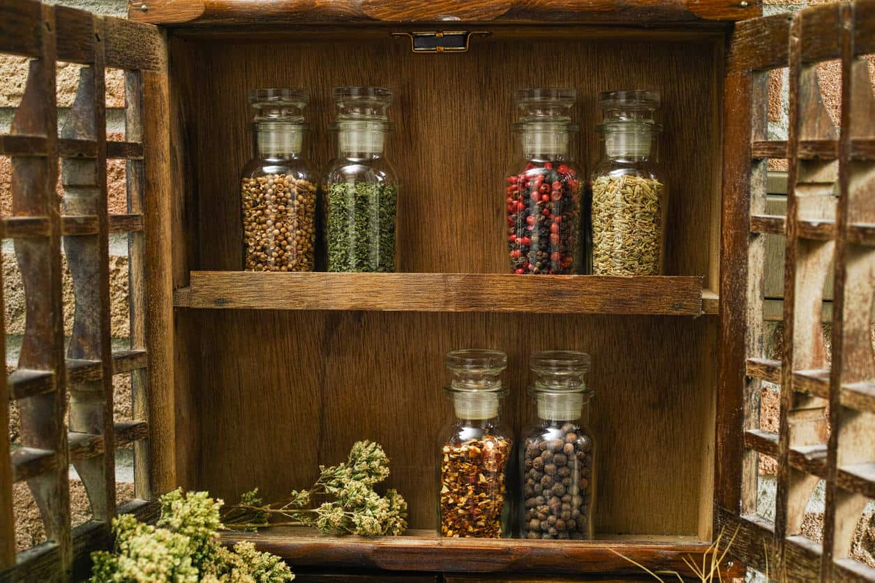 A rustic spice rack is a very stylish addition to your kitchen. Be sure to place it on an ideal place.