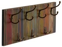 This wood mounted coat rack features multi-colored wood panels and 7 metal hooks.