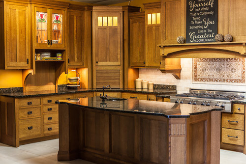 The most stunning detail of this Craftsman kitchen is the stained glass fronts of one of the back-lit upper cabinets. A large center island adds functionality to the simplicity of the design.