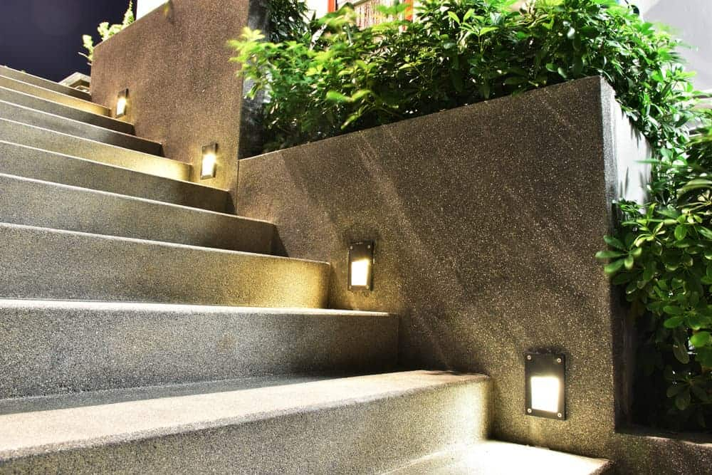Outdoor steps with lights on the side.