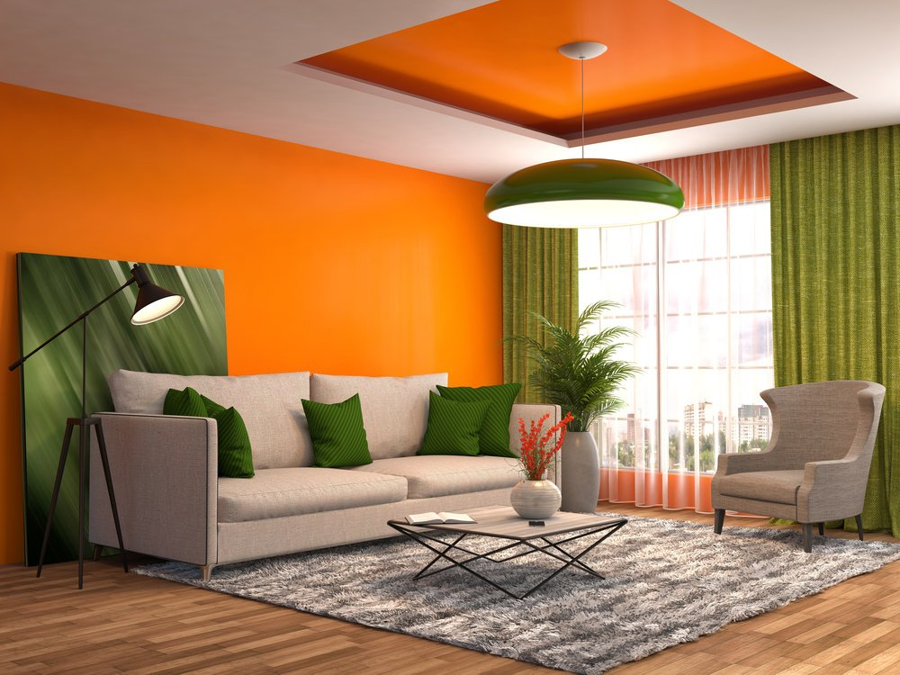 Orange looks very attractive when paired with green, doesn't it? Take a look at the orange wall with the leaning frame of green shaded artwork, the green palms and the throw pillows. They are all quite lively. The grey tone allows the bright colors to stand out, especially on the ceiling with the orange centerpiece and green pendant light. Let's give credit to the orange blossoms in the grey vase too!