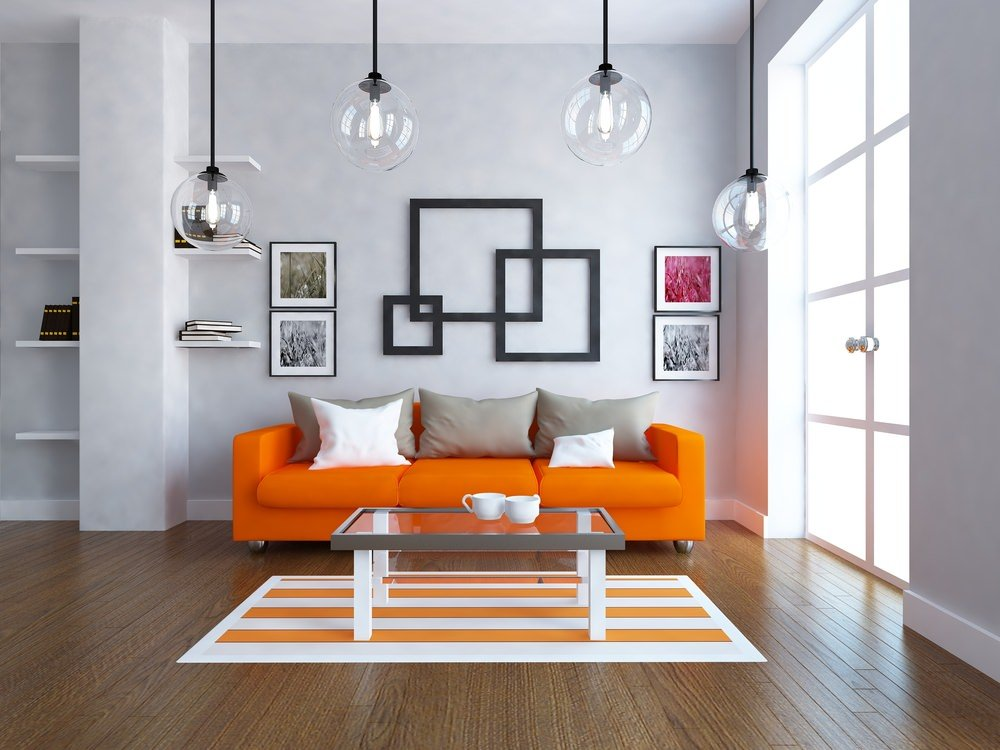 This is a stunning contemporary design with plain and simple surfaces and forms. Bright daylight from a large glass door strikes the orange sofa set and orange patterned floor rug on the wood parquet flooring.