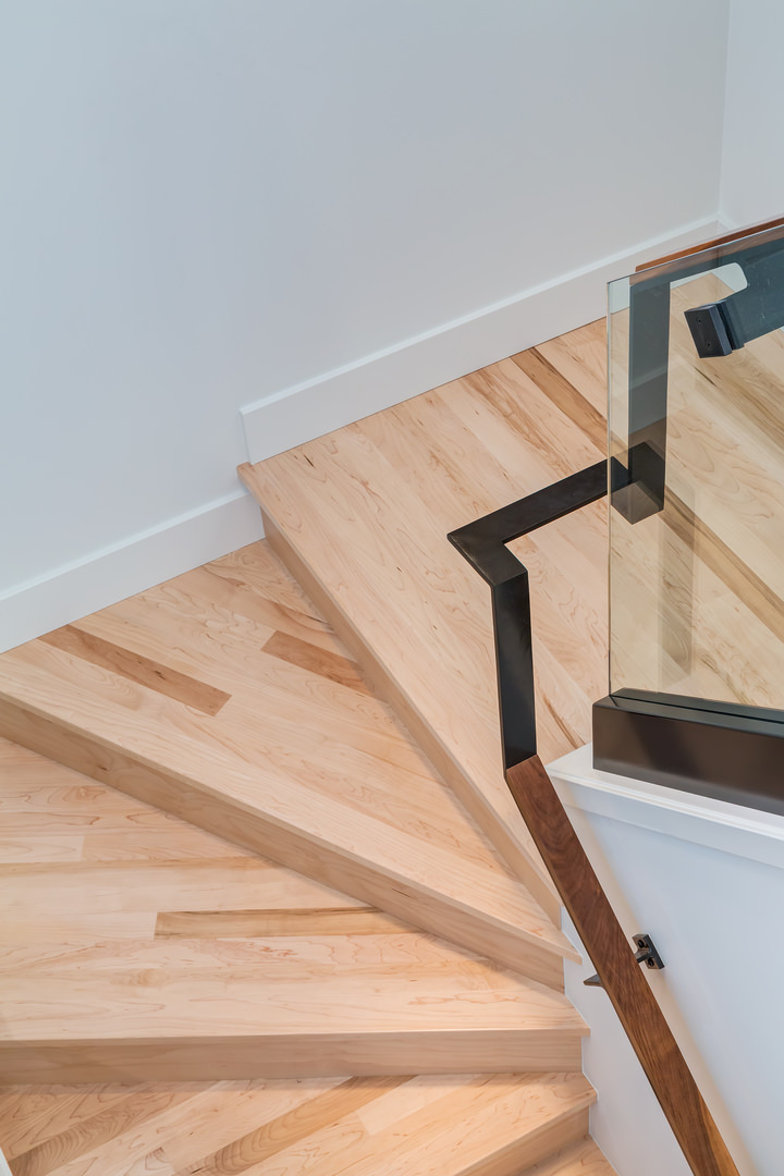Beautiful wooden steps accent the front entry.