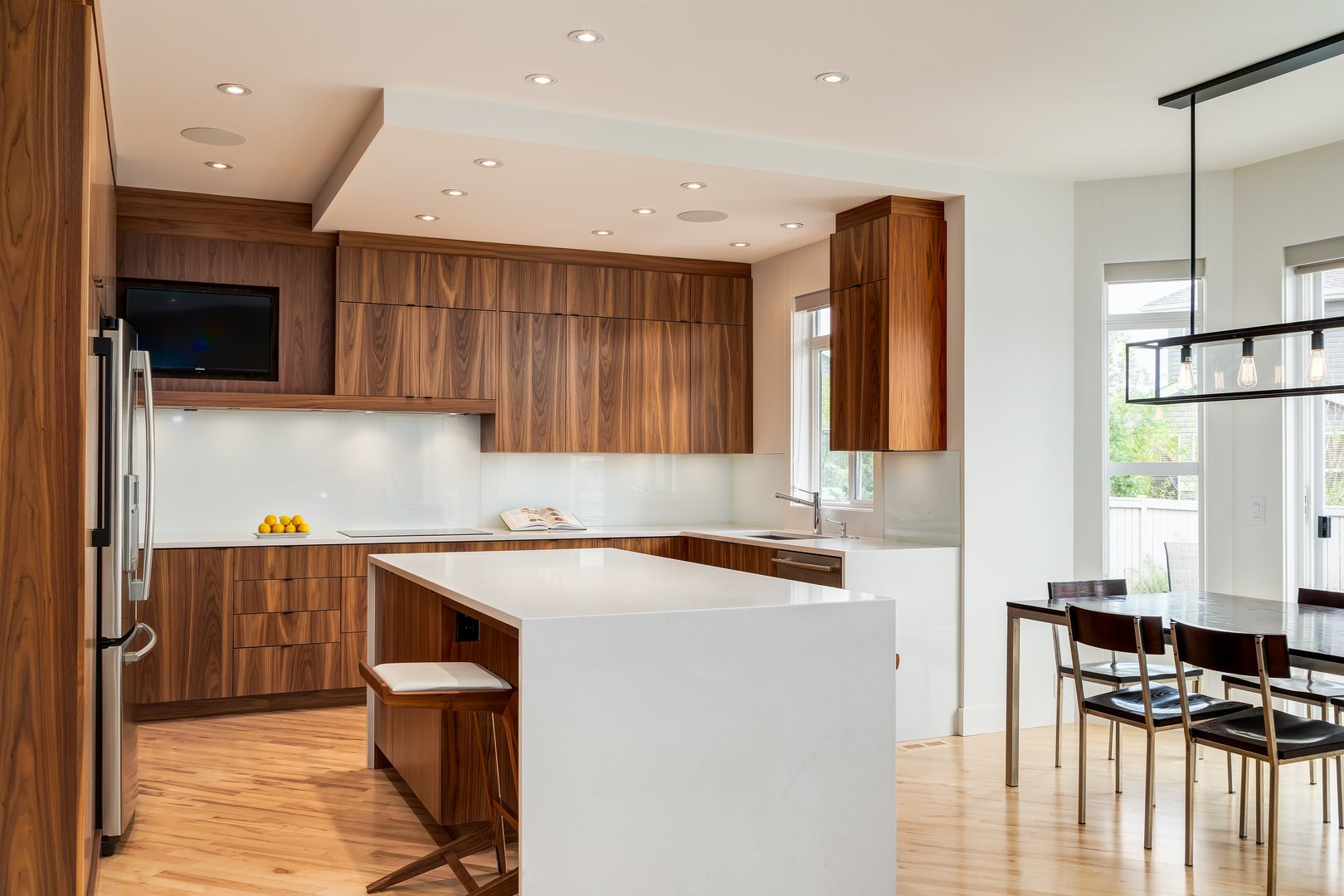 The kitchen is directly linked to the dining room. The most beautiful thing about the dining room are the overhanging black lights which gives this house a beautiful look. Just imagine turning those on at night when you sit for dinner!