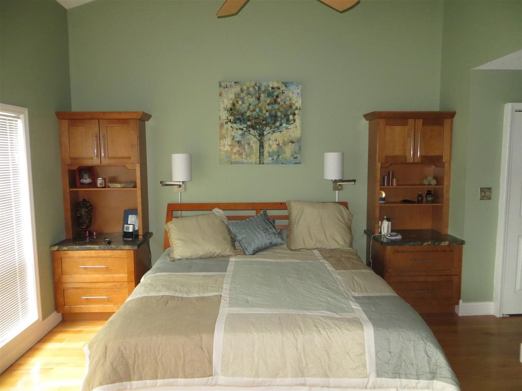 The nightstands above flanking the bed are ideal for small bedrooms because they provide drawer storage, a surface for nightstand elements such as an alarm clock, books, magazines, tablet, mobile phone, etc. and then there is shelving above.