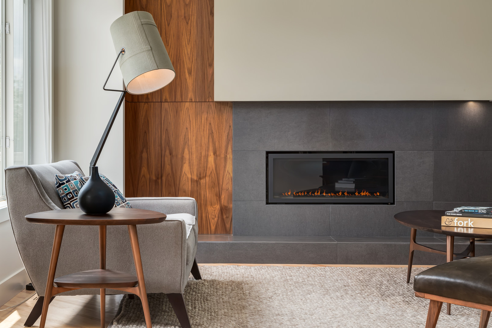 Another brilliant thing about this Deana Lewis design is the fact that the millwork gives the house a clean finish and is the most durable in this case. For example, in the living room you can see another colour added to the scheme which is some place between gray and black.