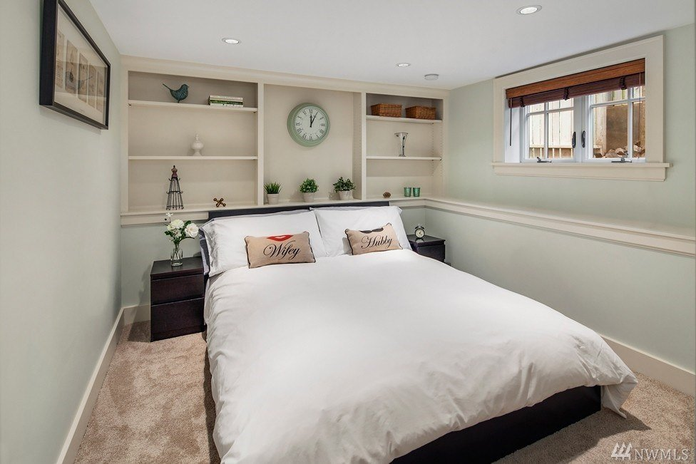 Here's smart use of wall space above the bed which allows for more storage.