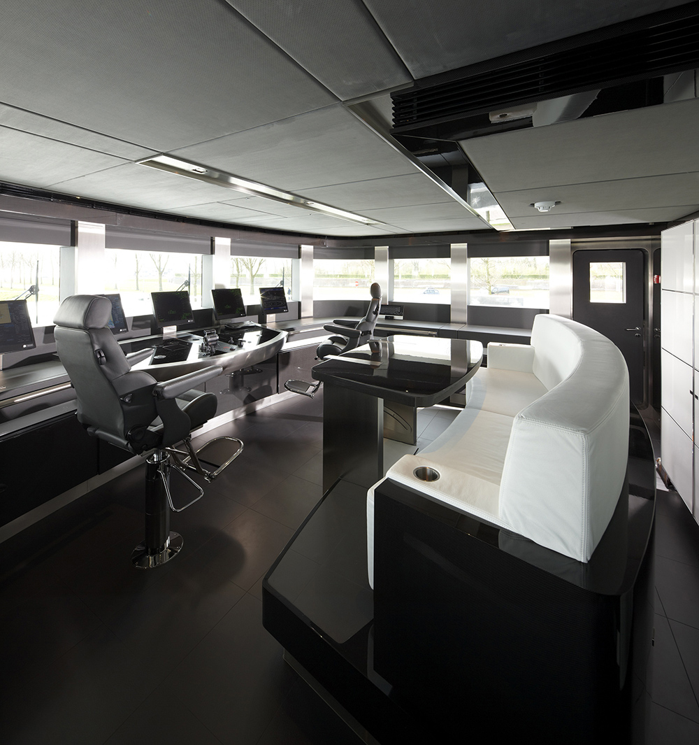 This is the command bridge secured with high tech equipment and ergonomic furnishing like the soft white leather sofa with black glossy desk.