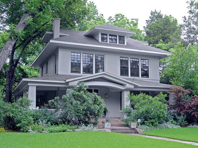 Beautiful grey foursquare home on large lot. This one is not as elevated as most; the porch is almost street-level.