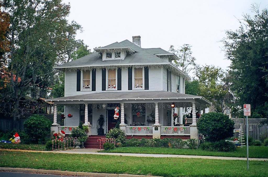 Original American foursquare home with wrap-around porch and smaller than usual windows.