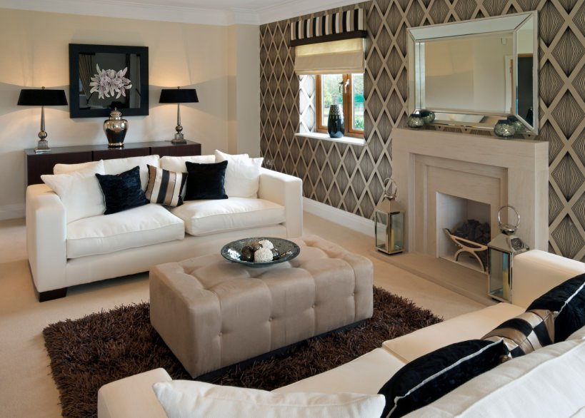 Given the warmer tones in this living room, the pair of white cushioned sofas brightens the tone a bit. Resting in between them is a thick fur rug and an ottoman.