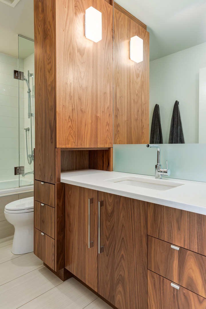 Another full bathroom with matching millwork and plenty of storage cabinet and drawers.