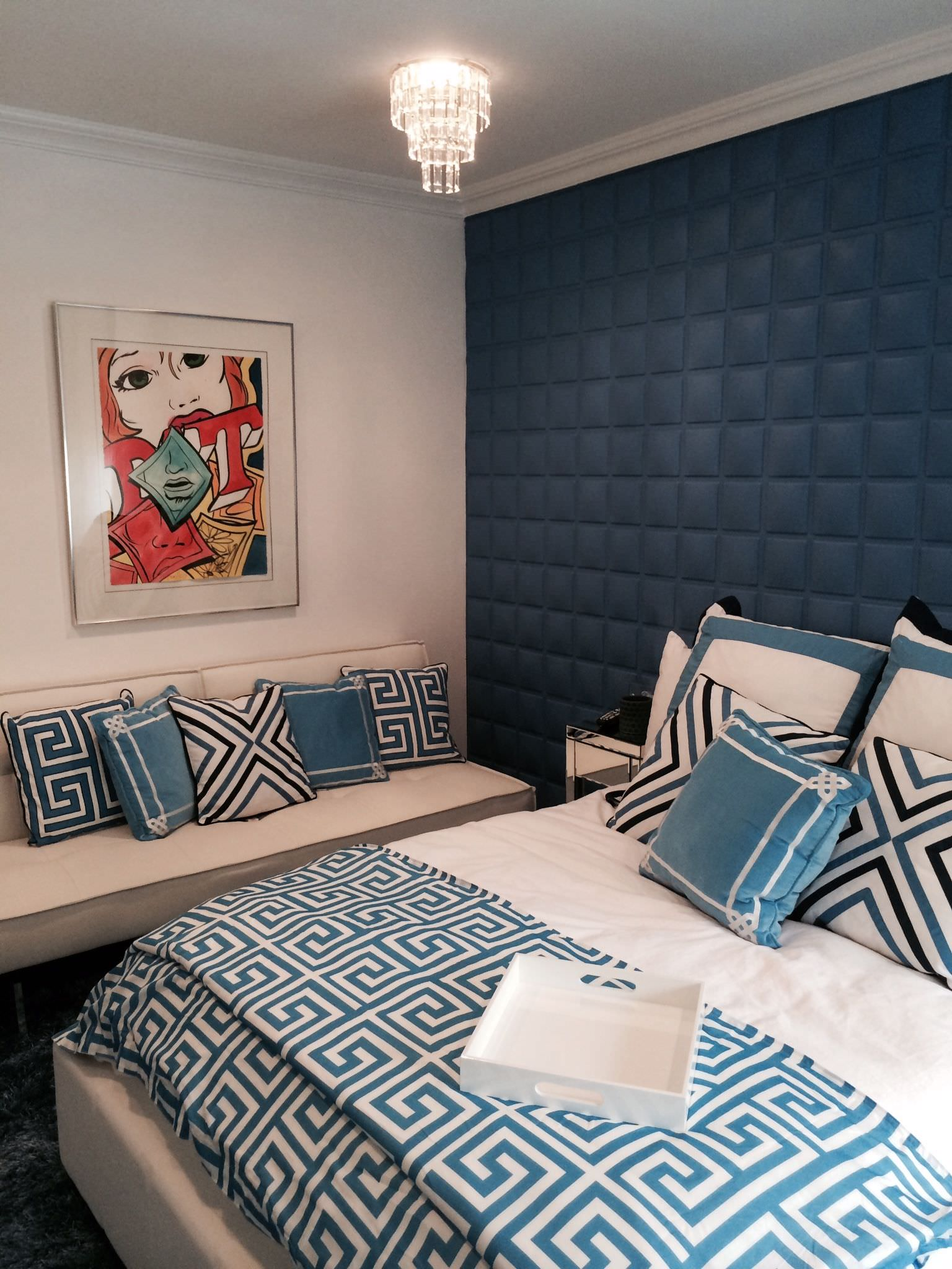 Small primary bedroom with matching color and pattern scheme