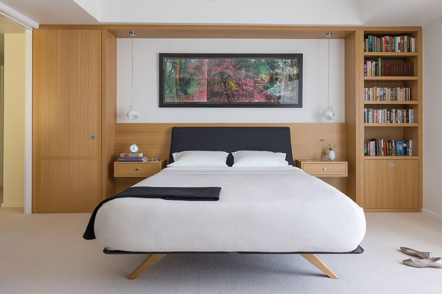 Built-ins beside and above a bed add depth and storage, both of which are perfect for small primary bedroom spaces.