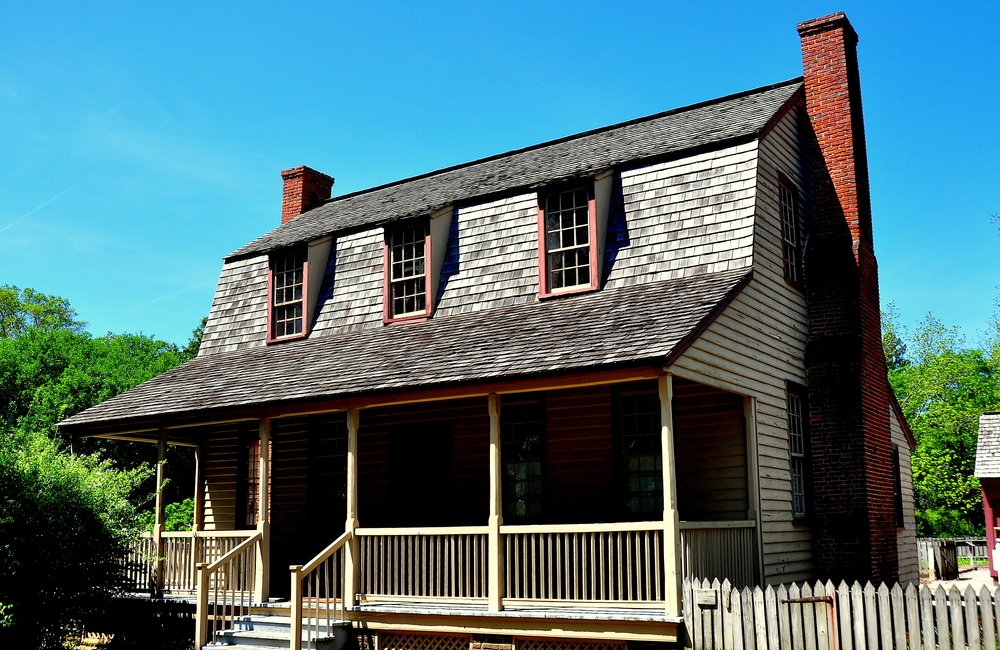 Here's a gambrel roof with a large overhang in the front creating a covered porch.