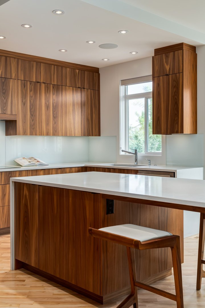 Smooth, sleek designed cabinets and countertops look bright and spacious.