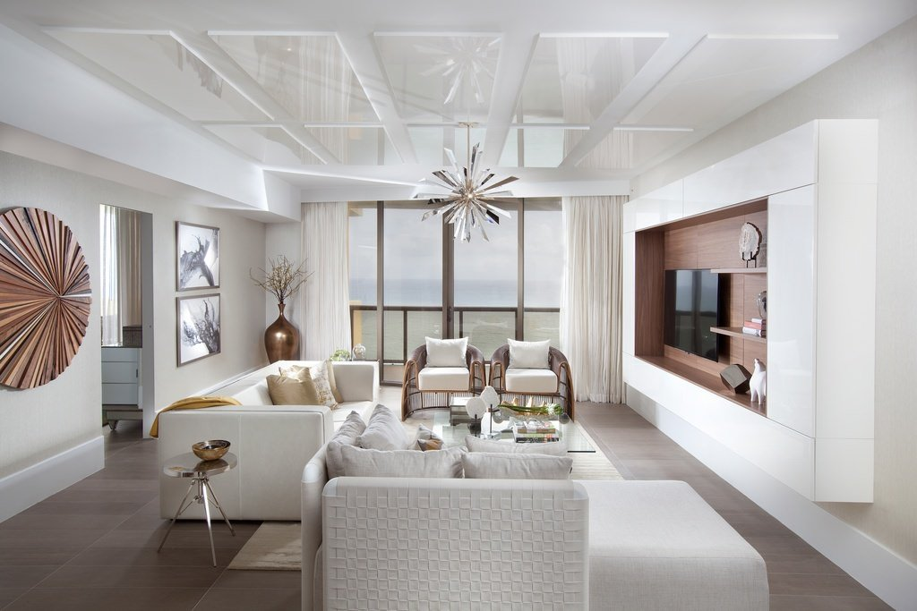 This is a sheer satisfaction of pureness and simplicity of color and design. A white sofa and pillows rest on a smooth wooden floor under the uniquely designed decors hanging on the wall and ceiling.