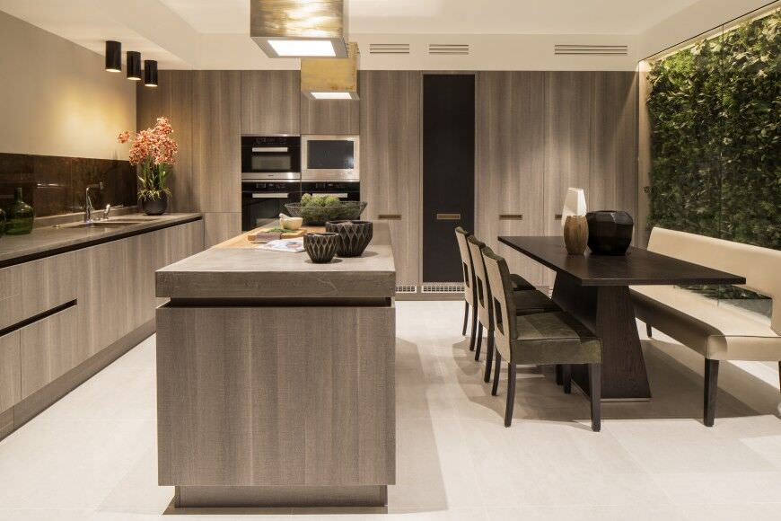 Modern kitchen design with 4 wall ovens (one may be a microwave). This is a serious cook's kitchen yet very minimalist in design.
