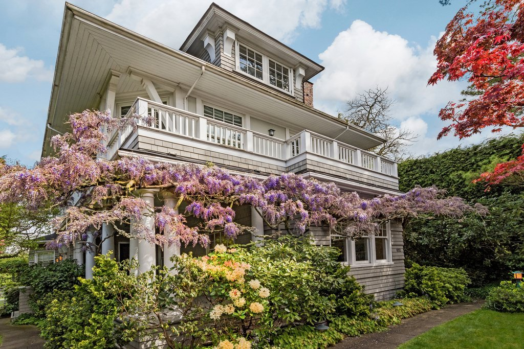 American foursquare home with shingle style exterior.