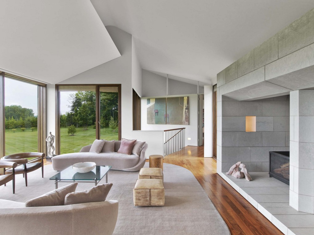 The interior of the house is designed in the most modern style, with bold lines and a stark aspect