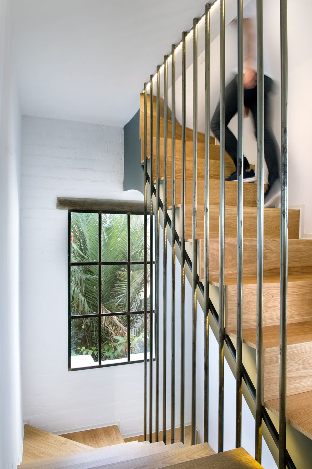 Spiral wooden staircase with a window on the side wall lets you glance out for nature viewing while walking upstairs, a high and sturdy railings are provided to give you hold.