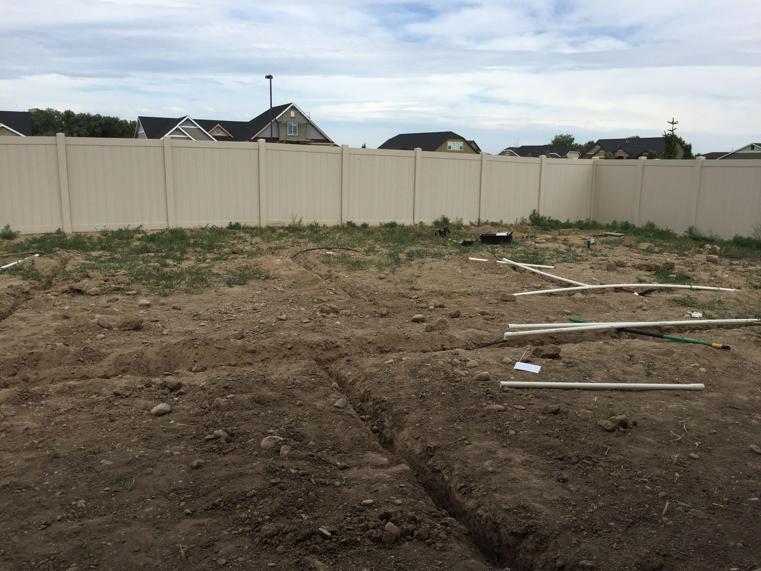 Preparing backyard to install DIY sprinkler system