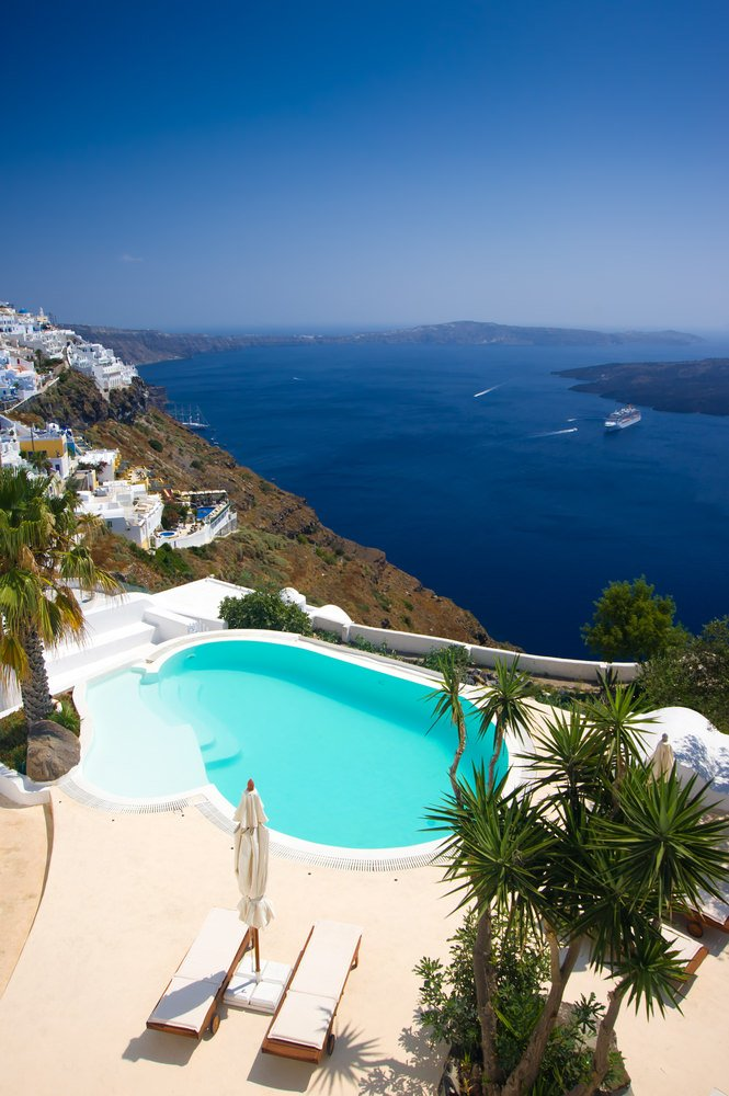 Here's a pool where the view is more spectacular than the pool. Small pool on patio overlooking the Mediterranean Sea.