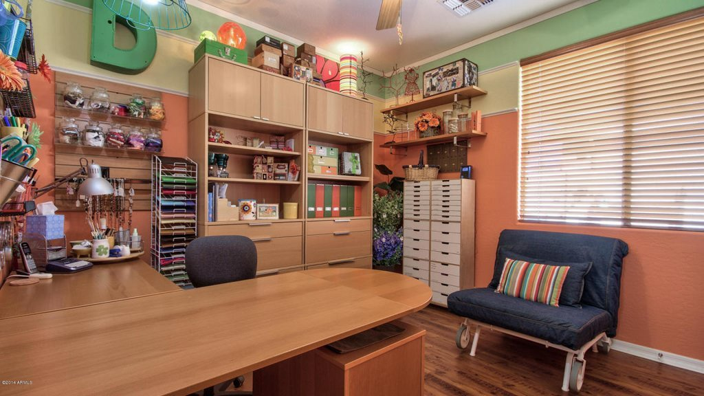 Built-In L-Shaped Sewing Work Station in Crafting Room.