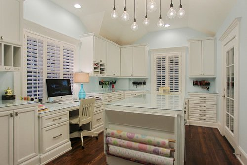 gorgeous white craft room and home office with gift wrapping station