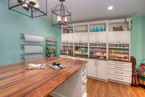 Green Craft Room With Custom Cabinetry And Large Crafting Work Surface