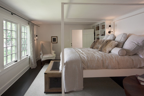 This master bedroom plays up its low ceiling with a whitewashed interior that lightens up the room and makes it look spacious and airy.Photo by Sullivan Building & Design Group