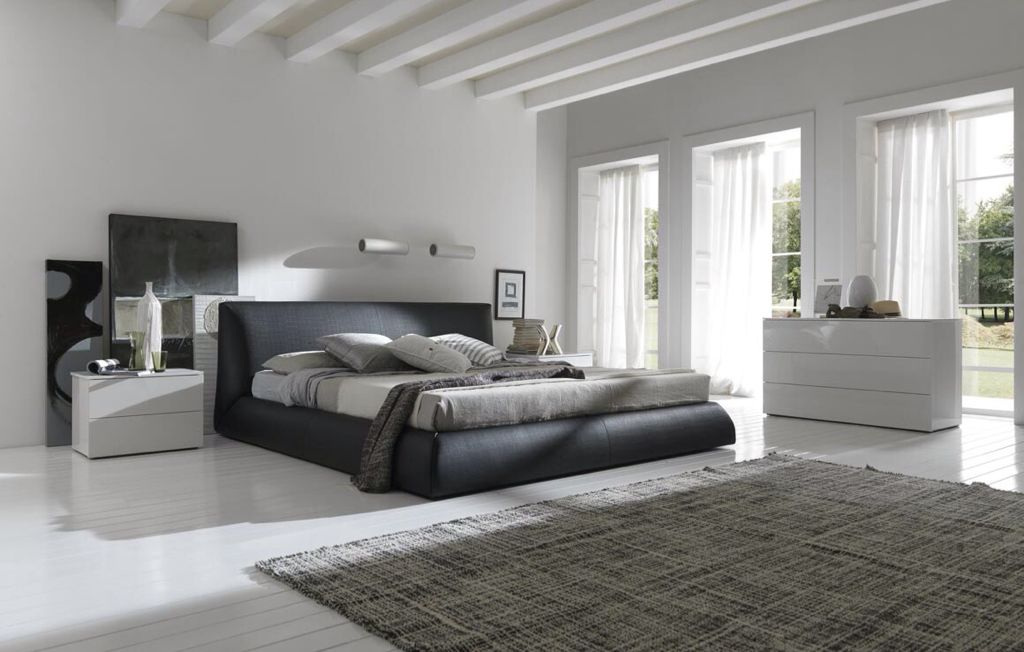 Cool tones dominate this master bedroom from the ceiling to the floors.