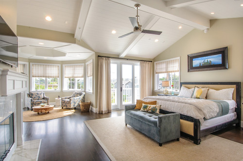 The overwhelming light palette of this master bedroom accentuates the natural lighting from the French doors and windows.Photo by Vitta Home Interiors & Design