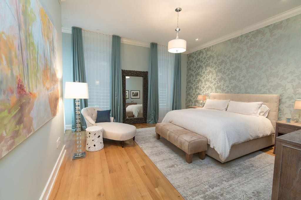 This master bedroom fills its space with cool colors, texture and patterns.