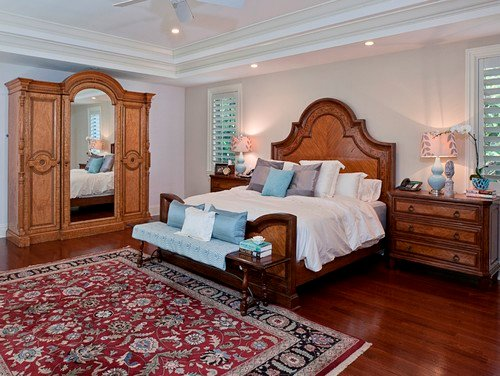 Dark wood flooring combine with this master bedroom's furniture to add a warm and rustic look.Photo by Diana Rodriguez