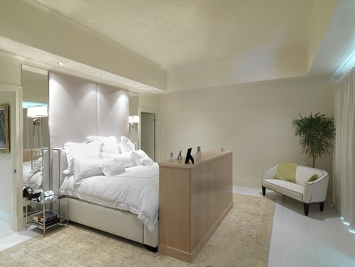 This master bedroom's whitewashed floor-to-ceiling look emphasizes its sparse appeal. Photo by Brookside Custom Homes, LLC.